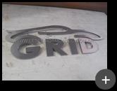 Letreiro de aço inox : Logotipo produzido com curvas sinuosas e letras para empresa Grid