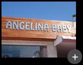 Letreiro de inox escovado instalado na fachada da loja de móveis e decoração infantil - Angelina Baby