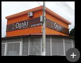 Letreiro completo da imobiliária Ogaki imóveis em aço inox polido