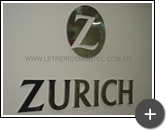 Letreiro Zurich Seguros, logotipo e letras confeccionadas em inox polido