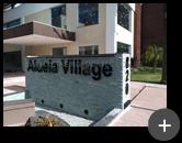 letreiro de acrílico preto 10mm instalado sobre a cascata para Aldeia Village com afastamento na parede